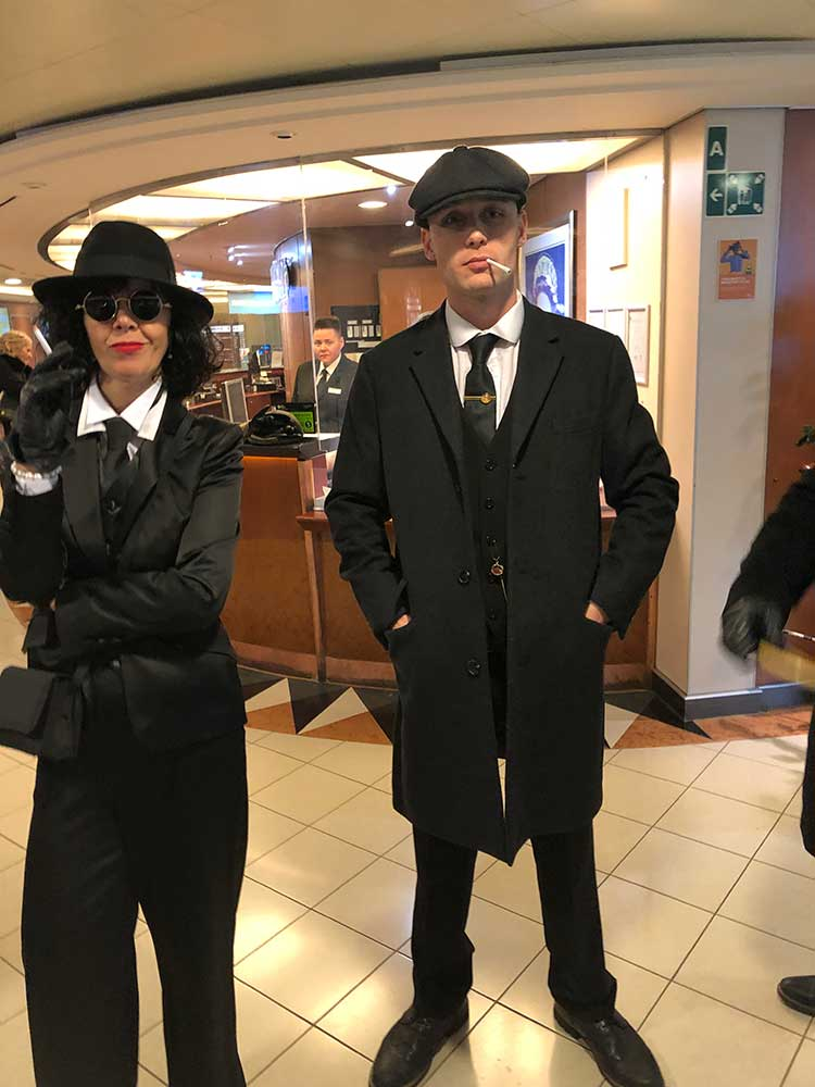 Peaky blinders lookalikes welcome us on board